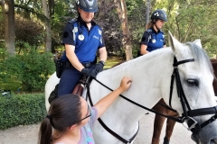 Emma pets the Police Horse