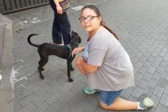 Emma Petting a Dog